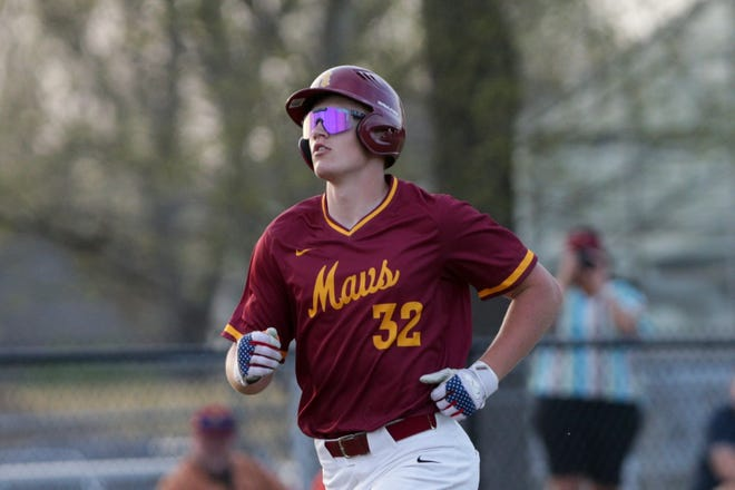 McCutcheon's Brody Fine (32) scores during the fifth inning of an IHSAA baseball game, Wednesday, April 7, 2021 in Lafayette.