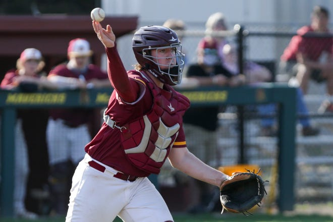 McCutcheon's Brayden Raeke (35) throws to first during the third inning of an IHSAA baseball game, Wednesday, April 7, 2021 in Lafayette.