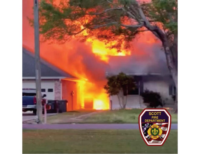 The Scott Fire Department battles an explosion and house fire that totaled one home and damaged another on March 6, 2021.