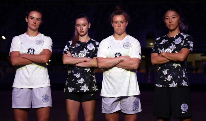 Racing Louisville FC recently unveiled its new midnight violet home kits, which include fleur de lis, butterflies and bees, as well as its white away kit.