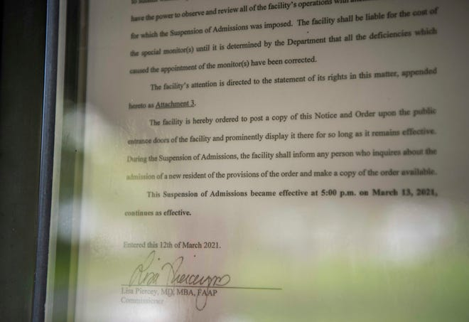 A state order, posted on the front door of J.B. Knowles Home Assisted Living, forbids the facility from accepting any new residents on April 8, 2021. State officials investigated the facility after a resident went missing and died in late February.