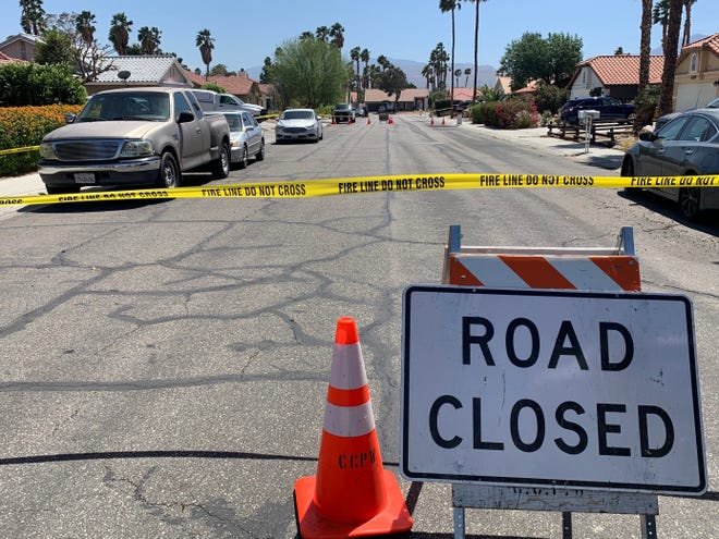 Yellow tape and a sign block a portion of Avenida Marquesa near Jarana Road in Cathedral City Thursday, April 8, 2021. Cathedral City police say they are investigating a homicide.