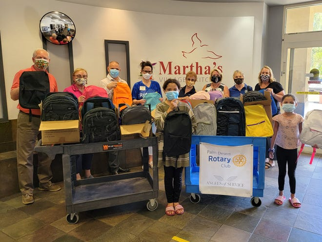 Martha's Village Executive VP Sam Hollenbeck joins  Rotarian Jennifer Loretta, Martha's Village & Kitchen Major Gift Officer and Rotarian George Sinatra, Jaimee Sul Baker, Rotarians Judy Graham, Carol Winston, Nancy Westerholm, Angelique Ontiveros and two young volunteers for the backpack assemblies.