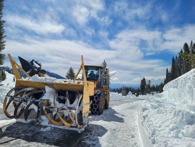 A rotary plow clears snow in a southwest section of the Lassen Volcanic National Park Highway in spring 2021.