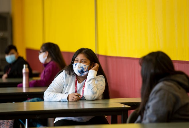 Gervais middle schooler Yesenia Lopez wears the contact tracing device on a lanyard around her neck. Each student wears the device, which logs when they have come within 6 feet of another person wearing the same device.