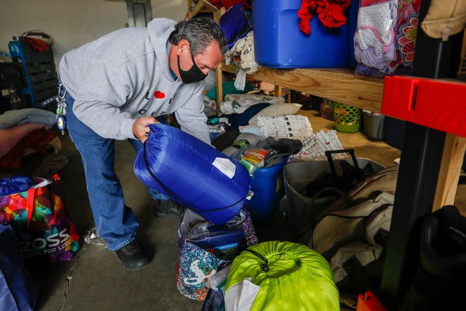 Philly, a volunteer at the Connecting Grounds, packs up supplies for the homeless whose camp was cleared out on Thursday, April 8, 2021.