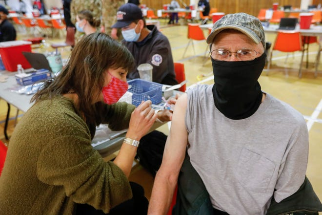 An Ava man receives a one-dose Johnson & Johnson COVID-19 vaccine at a Springfield-area clinic on April 8, 2021. On May 20, the Springfield-Greene County Health Department said that for the first time during the pandemic, no new deaths occurred in the county for two weeks in a row. Leaders urged everyone eligible to get vaccinated.