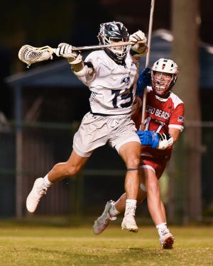 St. Edward's sophomore Rick Savage plays against Vero Beach in a boys lacrosse game on Wednesday, April 7, 2021, in Vero Beach. St. Edward's won 12-7.
