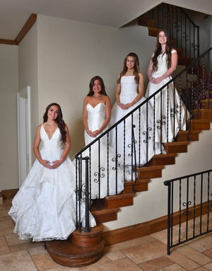 Young ladies presented in the 93rd Junior Forum Debutantes include, from left, Hannah Janae Earley, Allie Bren Garcia, Hayley Madison Gardner and Madison Marissa Gilmore. Not pictured: Karsyn Stilley Lindsey.