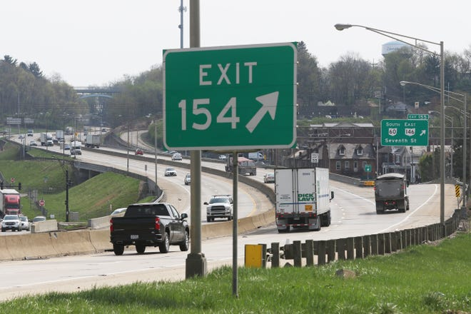 Traffic streams through Zanesville on Interstate 70 on Wednesday. The Ohio Department of Transporation will embark on a rebuilding program of the route through town later this year.