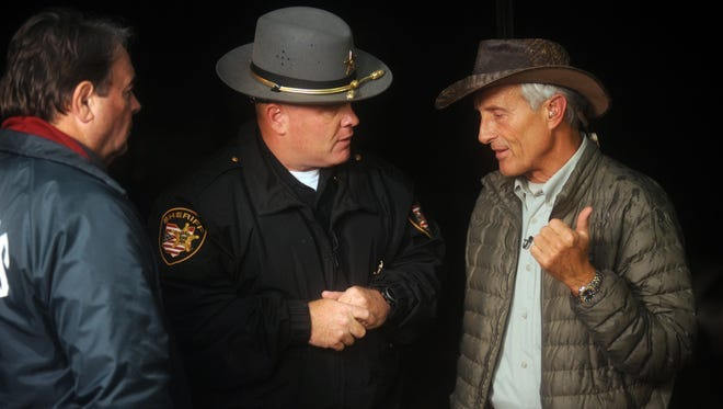 Muskingum County Sheriff Matt Lutz and the Columbus Zoo's Jack Hanna speak before a press conference after the 2011 exotic animal incident.