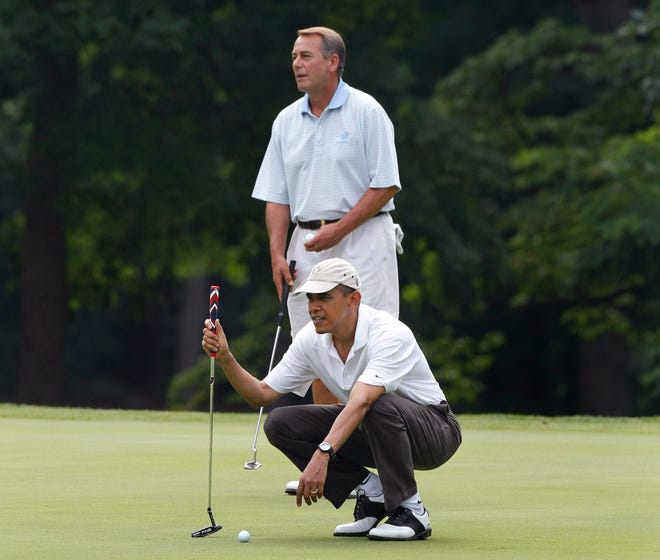 President Barack Obama and House Speaker John Boehner, R-Ohio, are on the first hole as they play golf at Andrews Air Force Base, Md.,  Saturday, June 18, 2011.