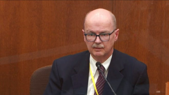 In this photo taken from the video, witness Daniel Isenschmid, a forensic toxicologist, testified as presiding Hennepin County Judge Peter Cahill, on Thursday, April 8, 2021, tried former Minneapolis police officer Derek Chauvin at the Hennepin County Court in Minneap .