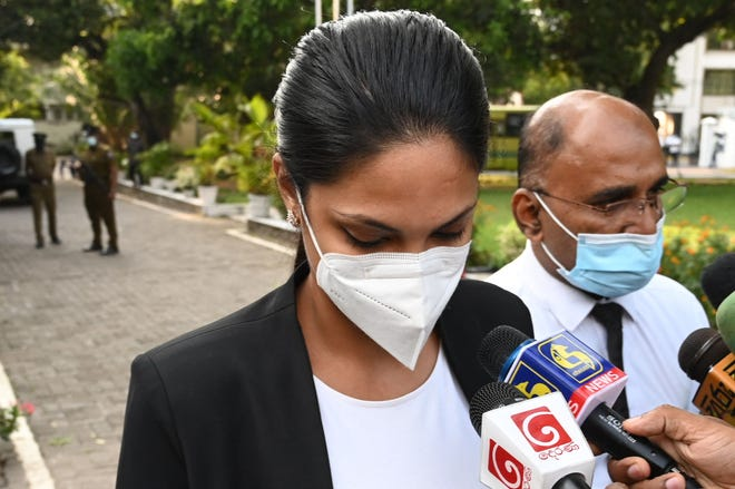 """Winner of Mrs. Sri Lanka 2020 Caroline Jurie leaves Cinnamon Gardens Police Station after being released on bail in Colombo on April 8, 2021 following her arrest on charges of assault over an on-stage fracas in which she pulled the crown off the head of the new """"Mrs Sri Lanka."""""""