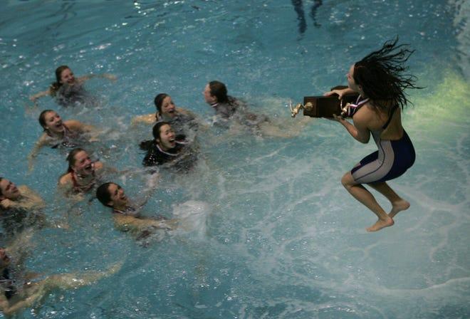 Naperville Central girls swim team celebrates state championship on Nov. 20, 2004, in Evanston, Ill.