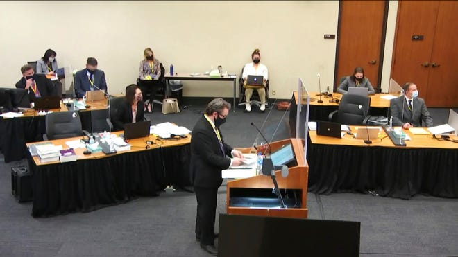 In this image taken from video, defense attorney Eric Nelson questions witness Daniel Isenschmid, a forensic toxicologist as Hennepin County Judge Peter Cahill presides Thursday, April 8, 2021.