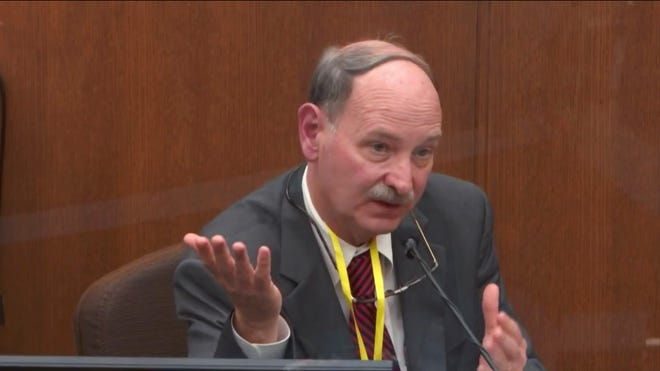 In this picture taken from the video witness dr.  Bill Smock, a Louisville forensic doctor, testified while Hennepin County Judge Peter Cahill presided on Thursday, April 8, 2021, at the trial of former Minneapolis police officer Derek Chauvin at the Hennepin County Court in Minneapolis, Minn.