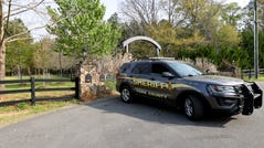 A York County sheriff's deputy is parked outside a residence where multiple people, including a prominent doctor, were fatally shot a day earlier, Thursday, April 8, 2021, in Rock Hill, S.C.