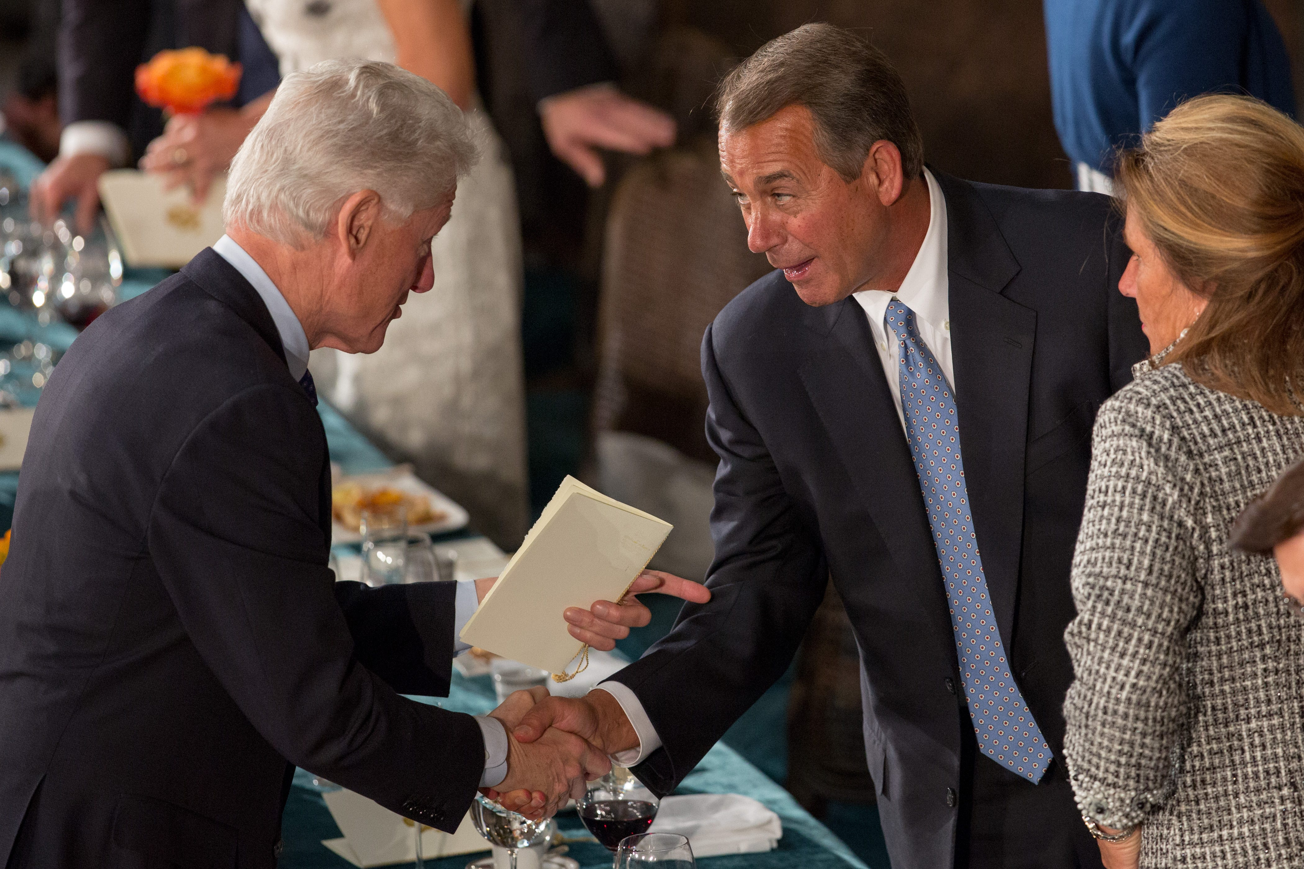 Former President Bill Clinton shakes hands with John Boehner in January of 2013.