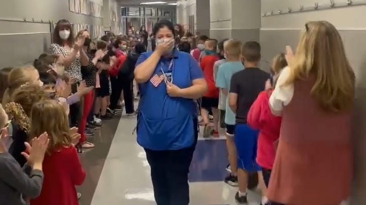 Students celebrate beloved cafeteria manager becoming a U.S. citizen