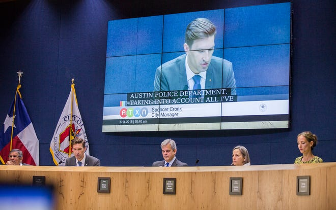City Manager Spencer Cronk, shown on the large screen above Austin City Council members at a 2018 meeting, runs the day-to-day operations of city government. Prop F would change that, putting City Hall under the control of a strong mayor.