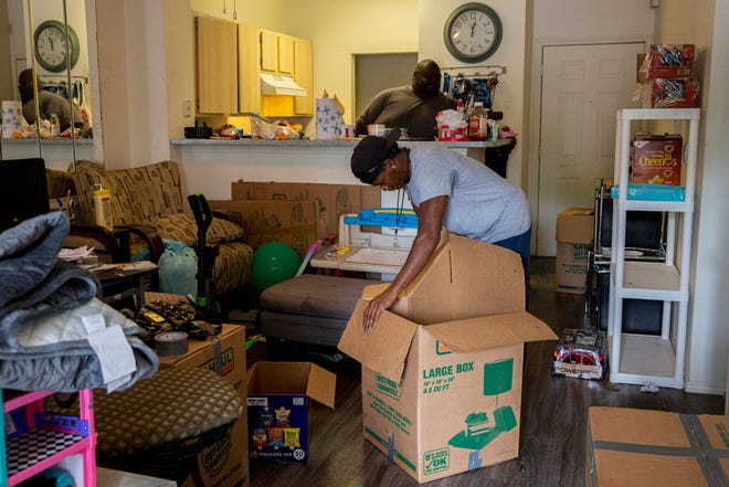 Calton Sanders, 44, puts together a box in his home at Tempo at Riverside apartment complex in Southeast Austin on Friday. Sanders was given a seven-day eviction notice after his apartment building was deemed unlivable after February's weeklong freeze.