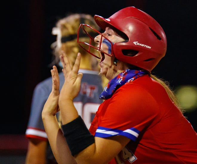 Hays Rebels' Amy Doherty celebrates her fourth hit of the game against the Lake Travis Cavaliers during the seventh inning at the District 26-6A softball game on April 8 at Lake Travis High School. Doherty and the Rebels beat Lake Travis 6-0 to stay in a tie with Bowie for first place in District 26-6A.