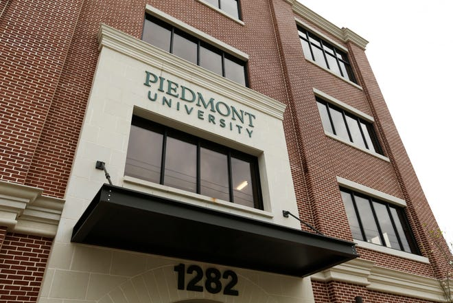 """Piedmont College faculty and staff held a """"U-Day"""" celebration of the college's growth and name change to Piedmont University at the university's new Athens campus on Thursday, April 8, 2021. (Photo/Joshua L. Jones, Athens Banner-Herald)"""