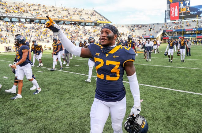 Nov 14, 2020; Morgantown, West Virginia, USA; West Virginia Mountaineers safety Tykee Smith (23) celebrates after defeating the TCU Horned Frogs at Mountaineer Field at Milan Puskar Stadium. Ben Queen-USA TODAY Sports