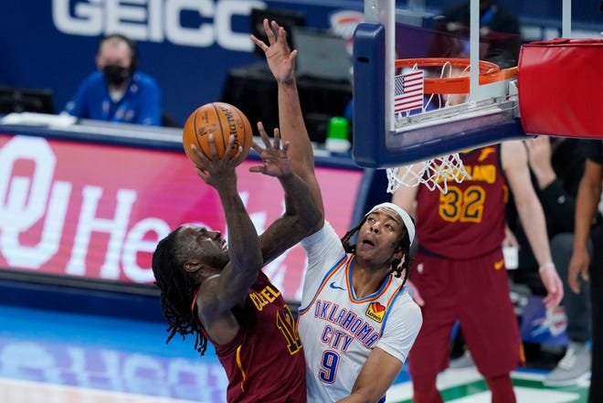 Cleveland Cavaliers forward Taurean Prince (12) shoots in front of Oklahoma City Thunder center Moses Brown (9) during the second half of an NBA basketball game Thursday, April 8, 2021, in Oklahoma City. [Sue Ogrocki/Associated Press]