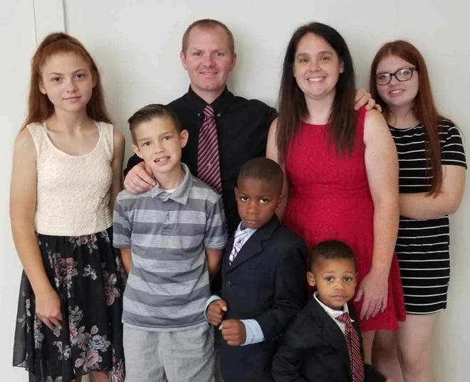 Pastor Todd Troyer, seen with his family, including wife Stephanie, has been installed as the new lead pastor of Alliance First Assembly of God Church.