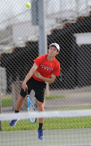 Alliance's Blake Hood, shown here during a match against Marlington last month, won his No. 1 singles match Monday against GlenOak.