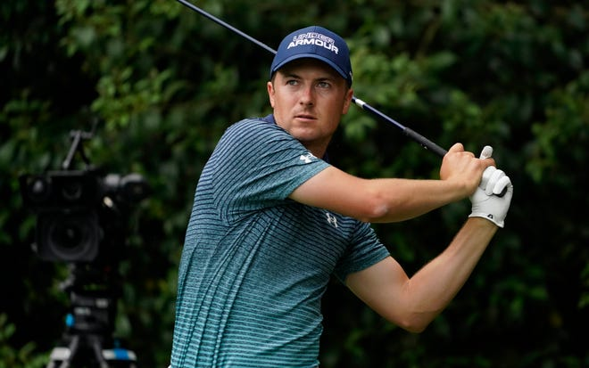 Jordan Spieth hits his tee shot on the 14th hole during the first round of The Masters golf tournament Thursday. The former Texas start posted a 1-under 71, six shots off the lead.