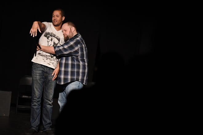 Brandon Dawson, left, and Eli Cranson improvise a scene during a 2015 improv show by Schrodinger's Cat at Le Chat Noir in Augusta. The improv troupe will entertain for the Bogey Night Comedy Bash on April 10 to raise money for Hunting For The Cure.