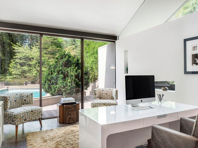 Fifty-four percent of Americans in a Pew Research Center survey last October said they would prefer working from home even after the COVID-19 pandemic fully subsides. This home office space was designed by interior designer Everick Brown in Harrison, N.Y.