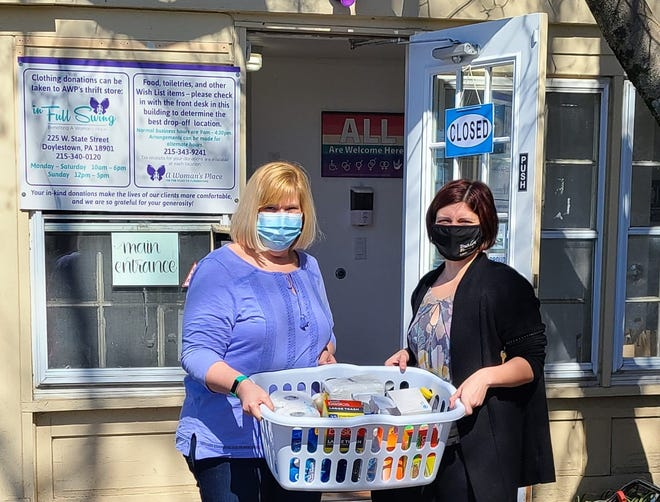 From left, Marianne Lynch, welcomes a delivery of cleaning supplies from Jillian Williams, branch manager with TruMark Financial of Doylestown. A Woman's Place  provides a full range of programs and services to individuals experiencing domestic violence. The visit was part of the credit union's community outreach initiative.