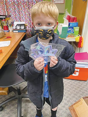 First-grader Blake Fraser chose thistiara for his little sister with the Bazinga bucks he earned.