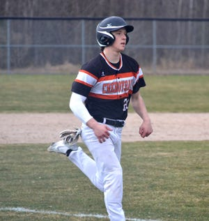 Cheboygan's Henry Stempky (20) heads in to score a run during game two of a varsity baseball doubleheader against Grayling in Cheboygan on Thursday.