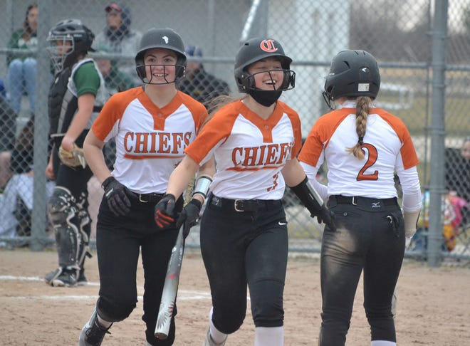 Cheboygan's Marley Couture (3) gets congratulated by teammates Cesley Stranaly (left) and Zoey Chamberlain (2) after hitting a home run in game two of a varsity softball doubleheader against Grayling in Cheboygan on Thursday.