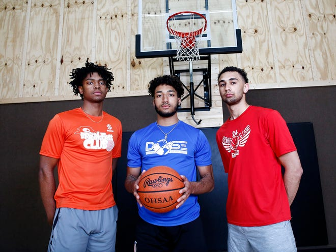 First team All-Metro boys basketball players, from left, Des Watson, Tasos Cook and D.J. Moore, pose during a workout. The three players train with another first-team selection, Sean Jones.