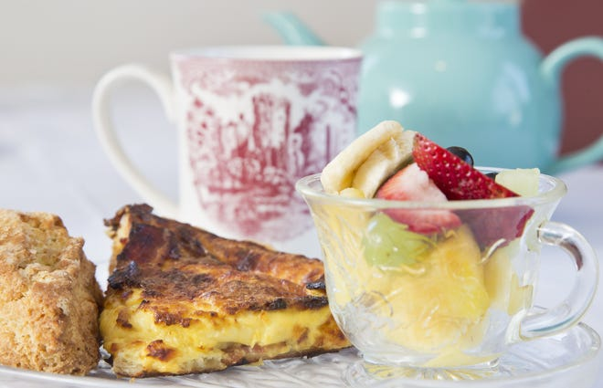 Quiche Lorraine with fruit and a cream scone from Cambridge Tea House