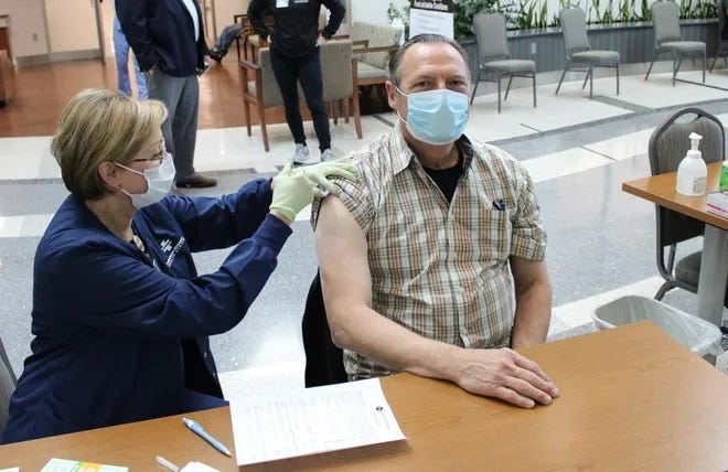 Lafourche Parish Sheriff Craig Webre gets his first dose of the COVID-19 vaccine earlier this year.
