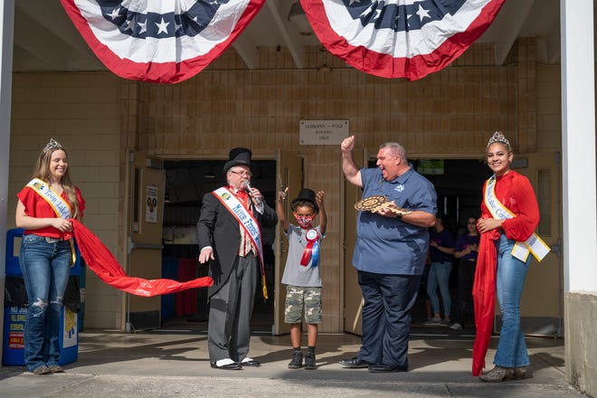 Mayor Ferris Wheeler, Jr. Mayor and Eustis Mayor Michael Holland cut the ribbon at the opening ceremony of the Lake County Fair on Thursday. [Cindy Peterson/Correspondent]