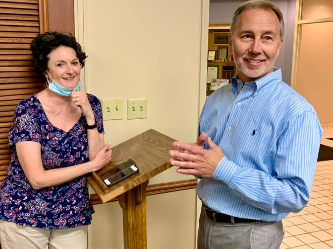 Mayor-elect Jim Hagaman, left, speaks with Spring Hill City Recorder April Goad at Spring Hill City Hall as the votes come in during Thursday's Election Day.