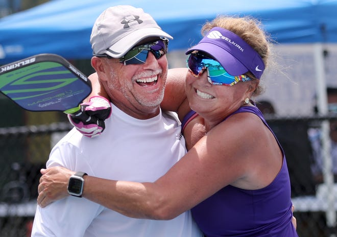 Sylvia Whitehouse hugs pardner Brad Redman, after pulling out a win, Friday April 9, 2021 during the Bainbridge Cup 2021 the International Federation of Pickleball Tournament at the Pictona pickleball complex in Holly Hill.