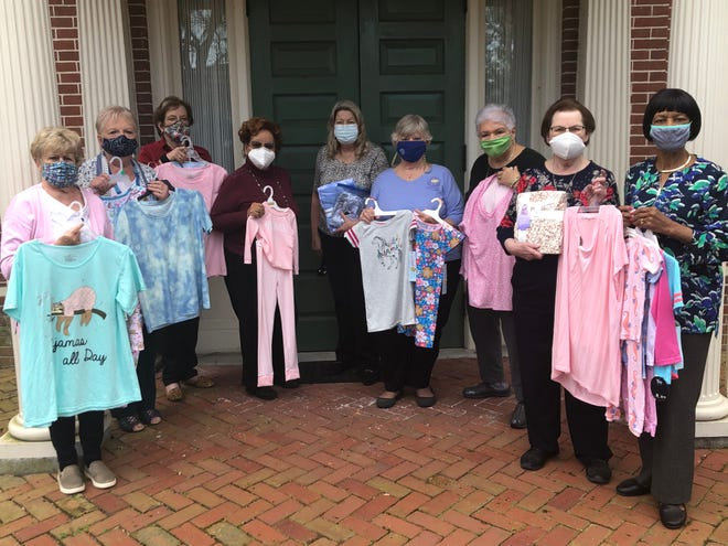 The Dover Century Club has donated pajamas and other nightwear to Child Inc., a leading advocate for Delaware's children by providing creative prevention and treatment programs for dependent, neglected and abused children and their parents. Pictured holding pajamas and other nightwear are Dover Century Club members, from left, Cecilia Knapp, Linda Dougherty, Pam Watkins, Cherritta Laws Matthews, Club Vice President Carolyn Forbes, DSFWC Past State President Carla Pyle (member of the GFWC Women's Club of Odessa), Elaine Crowell, Beverly Hulik and Mary Mills.