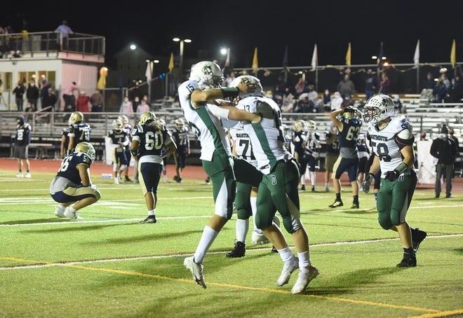 Dartmouth players celebrate their overtime win versus East Bridgewater, on Thursday , April 8, 2021. Dartmouth won the game in overtime 22-20 on East Bridgewater's 'senior night.'