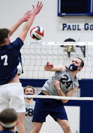 Erie First Christian's David Bahm, left, tries to block a shot by McDowell's Andrew Geisler in a Region 1 game on Thursday at McDowell's Paul Goll Gymnasium.