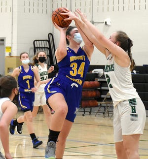 Mt. Markham Mustang Zoe Hoke (34) tries to get her shot off with Herkimer Magician Ariel Bell trying to block it during the second half of Thursday's game.