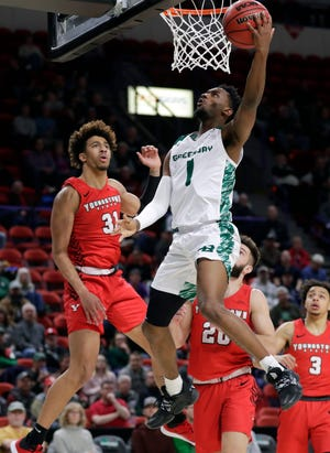 Wisconsin-Green Bay guard Amari Davis (1) shoots a layup during a game against Youngstown State on Feb. 27, 2020, at the Resch Center in Ashwaubenon, Wis.
